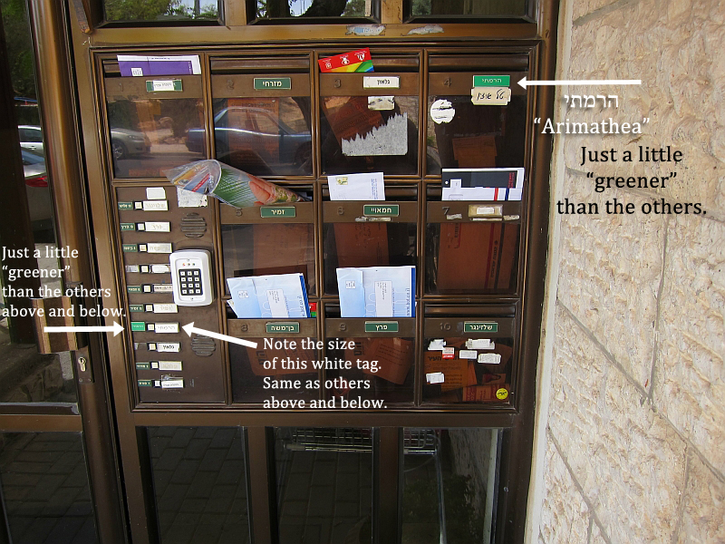 "An image of the mailboxes and doorbells of the apartment that sits above the so-called ""Patio Tomb"" in East Talpiot, Jerusalem. Note the different shade of green, typeset/font of the inscribed letters on mailbox 4 in comparison to the other signs. Note also the color of the slightly greener sign next to the doorbells."