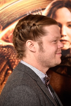 "LOS ANGELES, CA - NOVEMBER 17: Actor Elden Henson (hair detail) attends the premiere of Lionsgate's ""The Hunger Games: Mockingjay - Part 1"" at Nokia Theatre L.A. Live on November 17, 2014 in Los Angeles, California. (Photo by Frazer Harrison/Getty Images)"